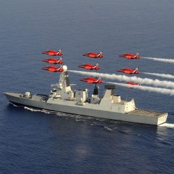The Red Arrows fly over the Royal Navy destroyer HMS Diamond as she sails past Cyprus.