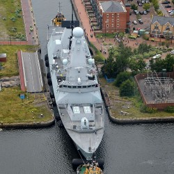 It's a tight squeeze as destroyer HMS Duncan is guided through a lock into Cardiff.